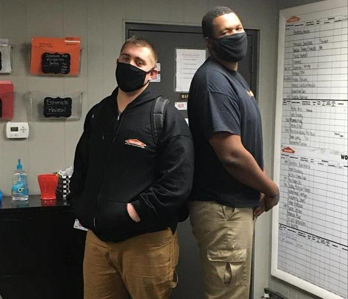 SERVPRO ready. Two male employees.